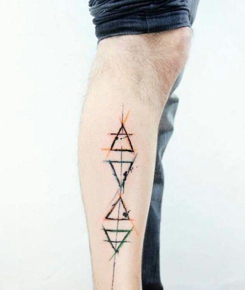 tattoo de Glifos en la pierna