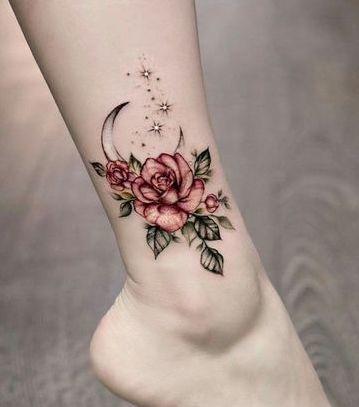 tattoo de flores en la pierna para mujer
